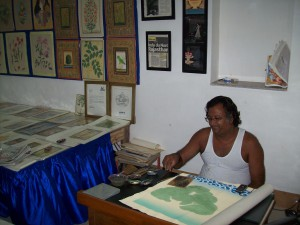 Raju swami working on a painting